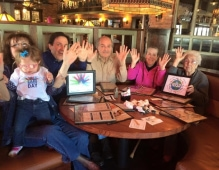Image of family around the table for rare disease day