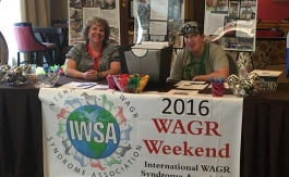 Image of 2 people at front desk of WAGR Weekend 2016